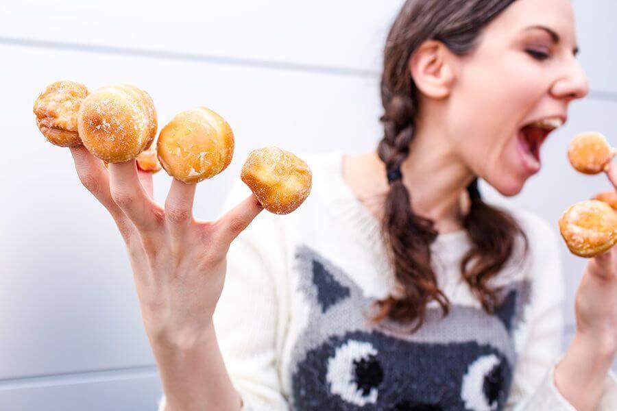 girl eating donuts