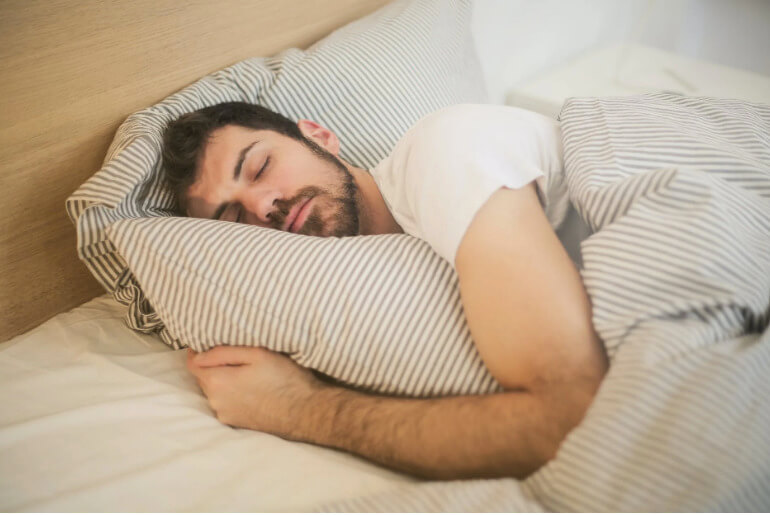 man getting enough sleep