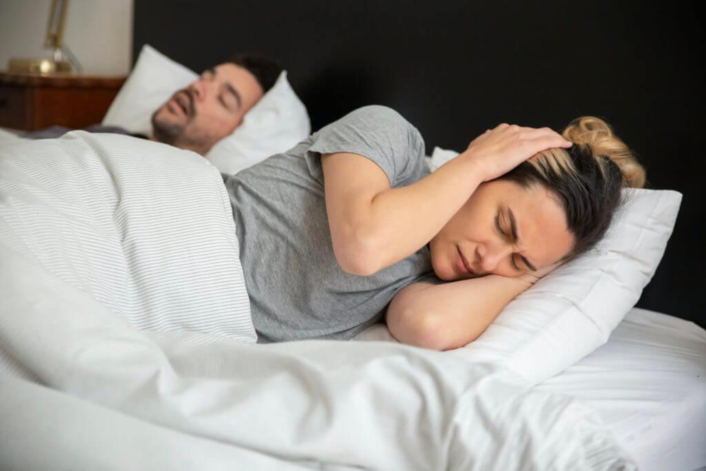 woman next to snoring partner